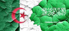 Algeria flag with Saudi Arabia flag on a grunge cracked wall Stock Illustration