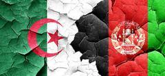 algeria flag with afghanistan flag on a grunge cracked wall - stock illustration