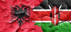 Albania flag with Kenya flag on a grunge cracked wall Stock Illustration