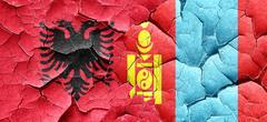 Albania flag with Mongolia flag on a grunge cracked wall Stock Illustration