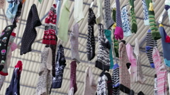 Clothing market, socks hanging on the rope in the Turkish market in the summer Stock Footage