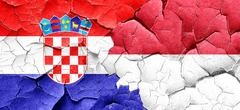 Croatia flag with Indonesia flag on a grunge cracked wall Stock Illustration