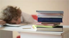 Schoolchild do homework. The boy does his homework at home. pupil has been bored - stock footage
