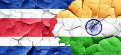 Costa Rica flag with India flag on a grunge cracked wall - stock illustration