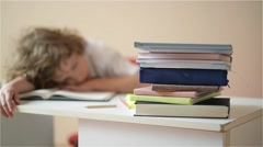 Schoolchild do homework. The boy does his homework at home. pupil has been bored Stock Footage