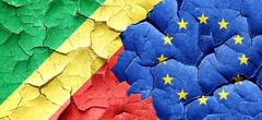 Congo flag with european union flag on a grunge cracked wall - stock illustration