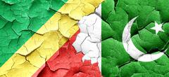 Congo flag with Pakistan flag on a grunge cracked wall Stock Illustration