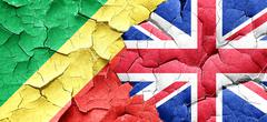 Congo flag with Great Britain flag on a grunge cracked wall Stock Illustration