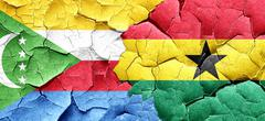 Comoros flag with Ghana flag on a grunge cracked wall - stock illustration