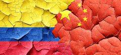 Colombia flag with China flag on a grunge cracked wall Stock Illustration