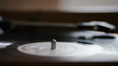 4K Camera moves from record to needle as it spins on a record player Stock Footage