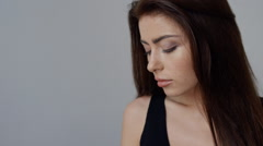 Close-up of beautiful young brunette woman with natural make-up and straight Stock Footage