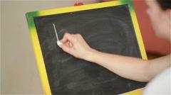 Writing on the blackboard, back to school - stock footage