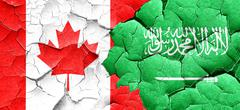 Canada flag with Saudi Arabia flag on a grunge cracked wall - stock illustration