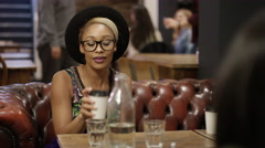 4K Portrait smiling hipster girl spending time with friends in city coffee shop. Stock Footage