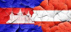 Cambodia flag with Austria flag on a grunge cracked wall Stock Illustration