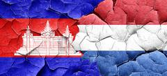 Cambodia flag with Netherlands flag on a grunge cracked wall - stock illustration
