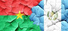 Burkina Faso flag with Guatemala flag on a grunge cracked wall Stock Illustration