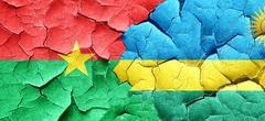 Burkina Faso flag with rwanda flag on a grunge cracked wall - stock illustration