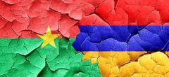 Burkina Faso flag with Armenia flag on a grunge cracked wall Stock Illustration