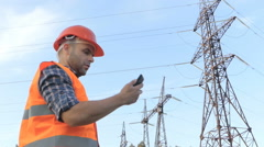 Electrical engineer looked at the phone, time. The end of the working day. Stock Footage