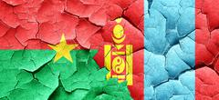Burkina Faso flag with Mongolia flag on a grunge cracked wall Stock Illustration