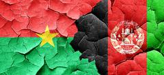 Burkina Faso flag with afghanistan flag on a grunge cracked wall Stock Illustration