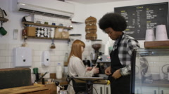 4K Portrait of friendly smiling worker standing behind counter in coffee shop Stock Footage