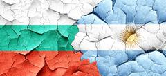 bulgaria flag with Argentine flag on a grunge cracked wall - stock illustration