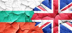 Bulgaria flag with Great Britain flag on a grunge cracked wall Stock Illustration