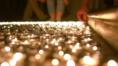 Lighting Up Candles of Prayer Stock Footage