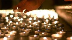 Woman Placing Her Candle on the Floor Stock Footage