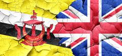 Brunei flag with Great Britain flag on a grunge cracked wall - stock illustration