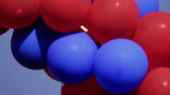 Red and Blue Balloons Daytime - stock footage