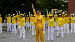 Falun Gong makes gymnastics in the square Stock Footage