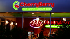 CherryBerry self-serve yogurt bar store front with open neon sign looped Stock Footage