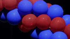 Red and Blue Balloons a Night - stock footage