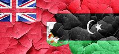 Bermuda flag with Libya flag on a grunge cracked wall Stock Illustration