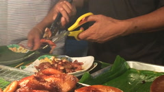 Thai style Street food grilled chicken or BBQ with charcoal ,Thailand Stock Footage