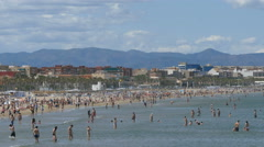 People on the beach of Cabanyal, Las Arenas - stock footage