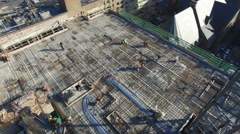 Workers on the roof of a building - stock footage