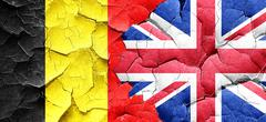 Belgium flag with Great Britain flag on a grunge cracked wall - stock illustration