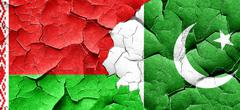 Belarus flag with Pakistan flag on a grunge cracked wall - stock illustration