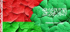 Belarus flag with Saudi Arabia flag on a grunge cracked wall Stock Illustration