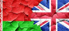 Belarus flag with Great Britain flag on a grunge cracked wall Stock Illustration