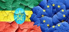 Ethiopia flag with european union flag on a grunge cracked wall - stock illustration