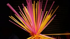 A day in the life of India - drinking straw decoration found on the street - stock footage