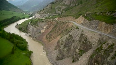 Mountain river and road. Outgo. Aerial Stock Footage
