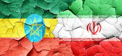 Ethiopia flag with Iran flag on a grunge cracked wall Stock Illustration