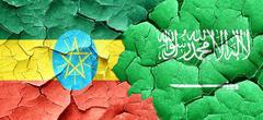 Ethiopia flag with Saudi Arabia flag on a grunge cracked wall Stock Illustration